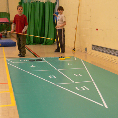 children playing shuffleboard