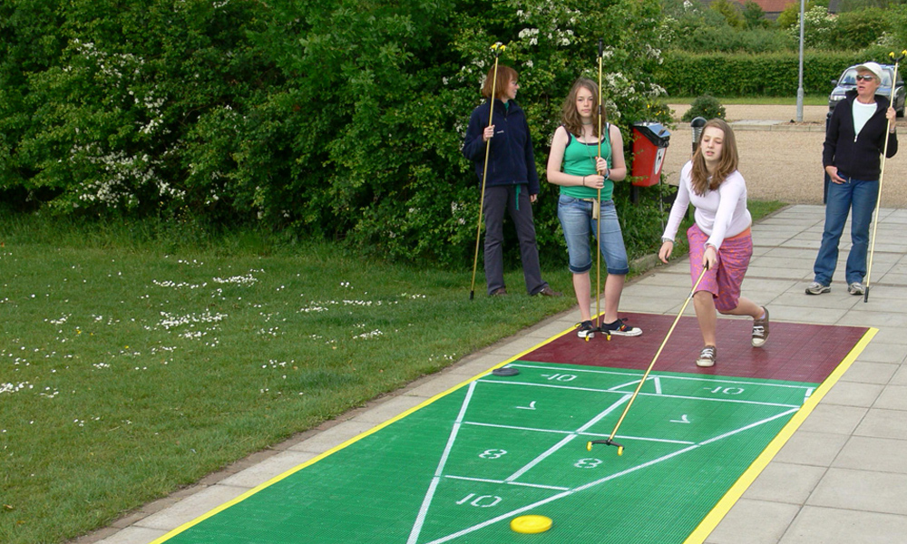 Playing shuffleboard outdoors